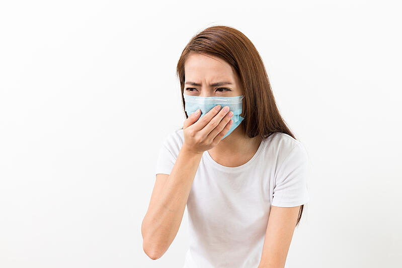 Asian woman sneeze with mask